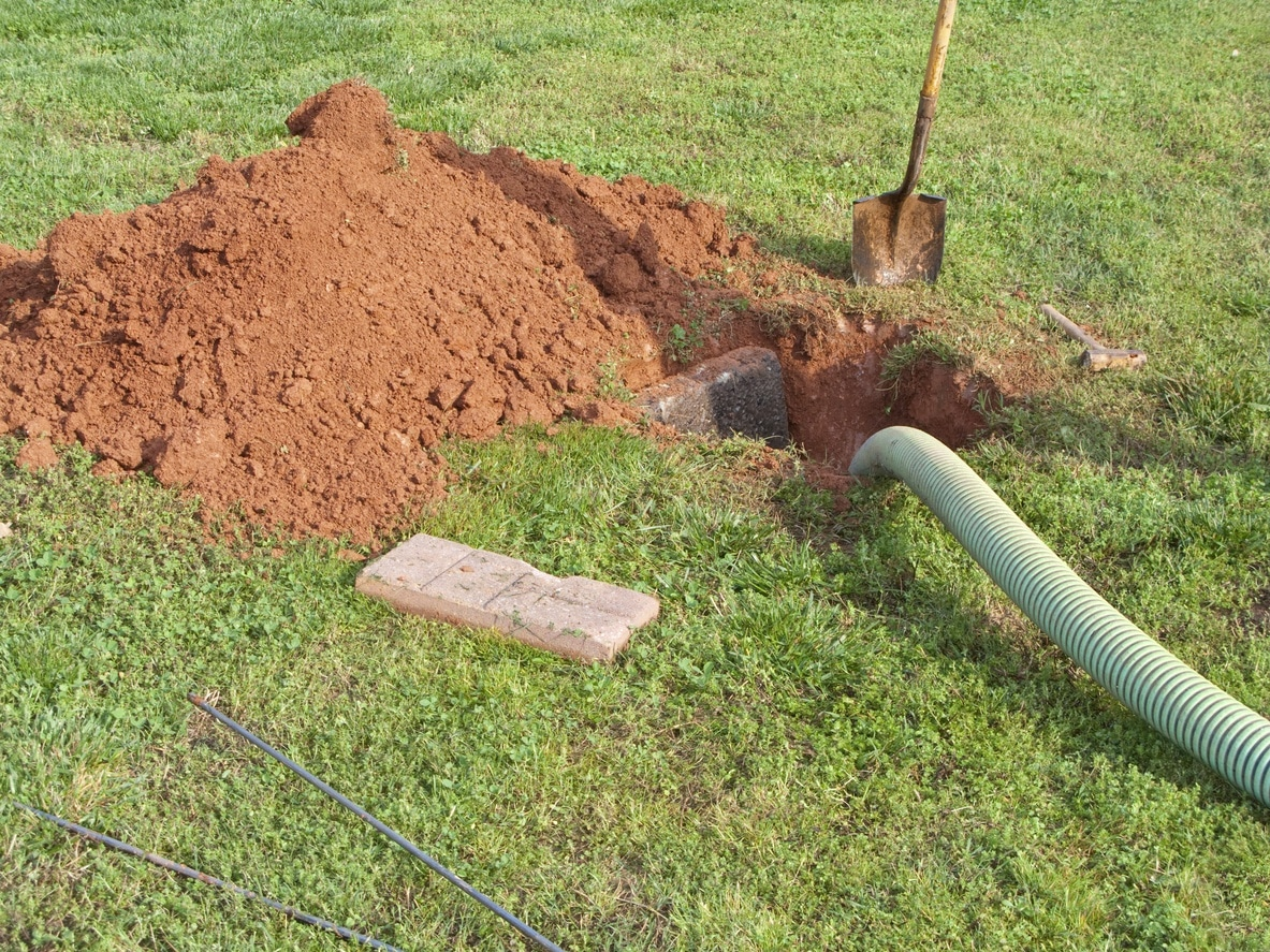 Open septic system being pumped